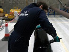 Once cured, one coat of Belzona 2141 (ACR-Fluid Elastomer) was applied